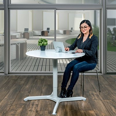 Luxor Pneumatic Height Adjustable Round Tables Person Sitting